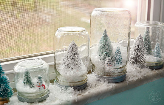 youll need glass jars in different sizes artificial snow glue spray paint and miniature christmas ornaments of your choice